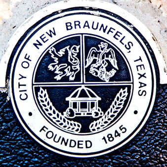 New Braunfels is a city near San Antonio, Texas. It's known for the Comal and Guadalupe rivers, which wind past leafy parks like Landa and Cypress Bend. Original 1800s German buildings like Gruene Hall are preserved in the Gruene Historic District. To the west, walkways snake through underground limestone caves at Natural Bridge Caverns. The Schlitterbahn water park has rides, slides and a wave pool.