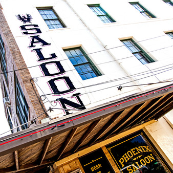 """Originally established in 1871, the Phoenix Saloon was the first bar in the state of Texas to serve women. It had a beer garden with a bell in a tree for service, an alligator pit, badger fights, live music weekly, and a parrot inside the front door trained to say """"Have you paid your bill?'"""" Though closed in 1918 due to the prohibition period, this chili parlor rose again as a historic Texas bar and live music venue."""