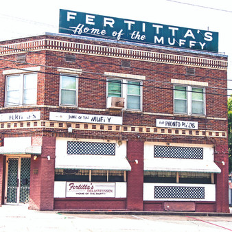"""Shreveport's oldest continually-operated restaurant, Fertitta's Delicatessen first opened in 1927 as the first Italian grocery in the city. Now listed on the National Register of Historic Places, the mom-and-pop sandwich shop specializes in muffalettas. Their signature sandwich, """"The Muffy,"""" is a smaller, single-serving version of the famous New Orleans cold cut sandwich topped with olive mix, mustard and American cheese."""
