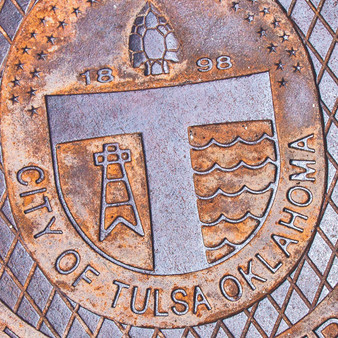 Marking the first progression of art deco architecture in Tulsa after World War I, this manhole represents beauty, but also history, power, and revolution.