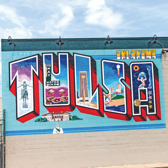 """With a rising art scene, Tulsa emphasizes its unique and colorful culture through a wall of murals. Being that this is one of the first points of interest as soon as you arrive in town, take Tulsa with you everywhere you go with this print full of charm. The artist behind the iconic """"Greetings from Austin"""" postcard mural repurposed this same theme on the walls of a Tulsa building, bringing life to this Tulsa Postcard Mural."""