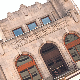 The Tulsa Union Depot is an impressive example of Art Deco architecture and reveals the inspiration of machinery as a theme for the exterior geometric designs. The Tulsa Union Depot is the former central railway station for Tulsa, Oklahoma. It has since been turned into an office building. The Oklahoma Jazz Hall of Fame is currently headquartered in the former Depot.