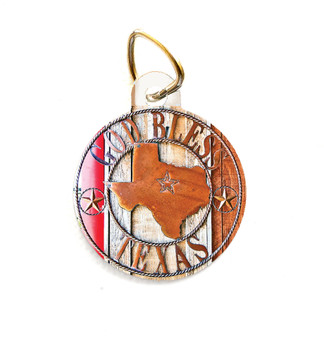 """This pet tag features an image of a """"God Bless Texas"""" sign."""