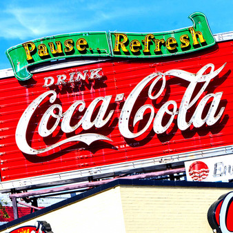 A historic Coke sign located above a Raising Canes in downtown Baton Rouge Louisiana.