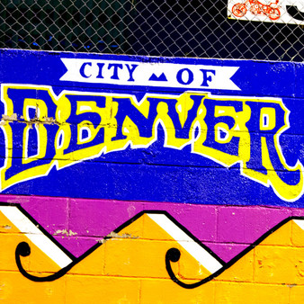 Welcoming tourists and visitors to Denver, the capital of Colorado, is this colorful mural. Featuring the infamous state colors, blue and yellow, the Old-Western atmosphere presented in this state is represented. With landmark 19th century buildings and architecture, as well as several remarkable museums, Denver is also home to many ski resorts near the well-renowned Rocky Mountains.