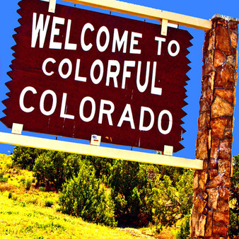 This iconic sign welcomes visitors to the great state of Colorado. This sign is located by Interstate I-80 in Mack, Colorado.