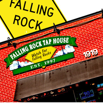 The Falling Rock Tap House is a bar and eatery that features a large outside patio, pool tables, and dart boards. This bar is located one block from Coors field in downtown Denver, Colorado.