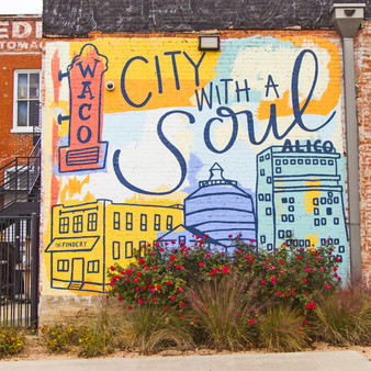 Featuring the ALICO Building, this Waco mural shows off its small-town pride and history. Letting everyone know where you are, City with a Soul has become a top destination.