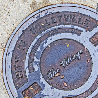 "This manhole features the ""old and new"" modern approach Colleyville takes, as a town. Being a quaint suburb, with a personal touch, Colleyville also honors and appreciates its original footsteps."