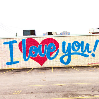 "Located in Deep Ellum – an area big on Jazz music and a night out on the town in the 1920's – is the social media famous ""I Love You"" mural. As Deep Ellum features several eccentric murals, this area has been coined with being an overall artsy and playful district, making it one of the best photo-op locations."
