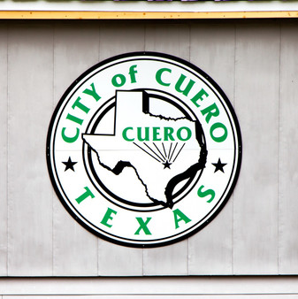 """The city of Cuero had formed in the mid-19th century as a stopping point on the Chisholm Trail cattle route to Kansas. However, it was not recognized as a town until 1873, when it was officially founded. The city was named for the Spanish word meaning """"hide"""", referring to the leather made from animal hides, though that industry was short-lived. As major hurricanes occurred in the 1870's and 1880's, Cuero's population grew considerably  Today, agriculture is still the primary industry in the region. Cuero is considered to be one of the top cattle producers and shippers in Texas."""