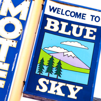 This blue and white sign marks the location of the Blue Sky Motel. This motel is conveniently located near restaurants, popular attractions, and historical sites in Lakewood, Colorado.