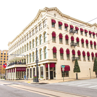 The Capital Hotel is a historic hotel at 111 West Markham Street in Little Rock, Arkansas. It is a four-story brick building with an elaborately decorated Victorian front facade. The hotel was, when it opened in 1877, the grandest in the city, and the building is still a local landmark.