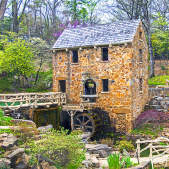 """Old Mill  is a historic re-creation of an 1880's water-powered grist mill. Also, it is in the opening scenes of the classic movie """"Gone With The Wind."""" It features sculptures by Senor Dionicio Rodriguez and is listed on the National Register of Historic Places."""