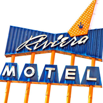 "Found on Colfax, which was once the ""Disneyland of Motels"", Riviera Motel earned its local fame by competing with other varying inns. With a bright blue color scheme and its large, over the top sign, this motel is one you surely can't miss."