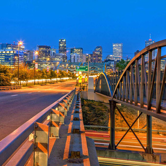 With its calm yet recognizable cityscape, The Denver Skyline can be best seen amongst these highway bridges. Welcoming you into the heart of its downtown is it's relaxed industrial, railroad-like features with its city's preserved nature.