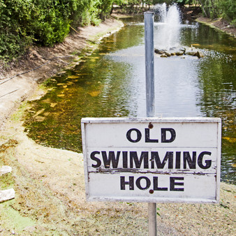 Making itself a historic landmark, this sign represents an old swimming hole known to man.