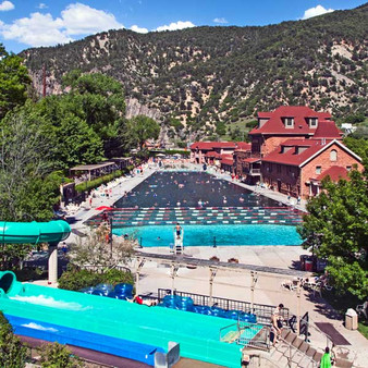 The historic Glenwood Hot Springs Resort is a massive, long-running hot-springs pool in serene mountain surrounds, located between Aspen and Vail, just steps away from Glenwood's charming downtown. The soothing atmosphere includes a spa, a premier athletic club, a resort boutique, and on-location dining for convenience.