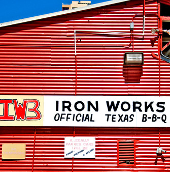 Originally an ornamental Iron Work shop owned and operated by the Weigl family, this little tin building was converted into The Iron Works BBQ in 1978. Shortly after opening their doors, the State Historical Commission registered the property as a historical site, honoring the Weigls and their legacy.