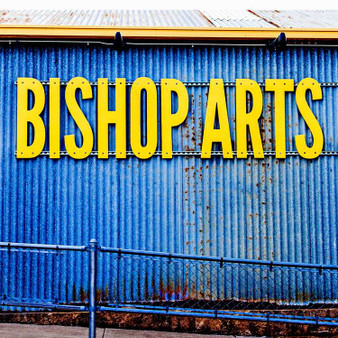 Welcoming you to the Bishop Arts District is this blue and yellow sign, pronouncing its bold personality and dynamic characteristics.