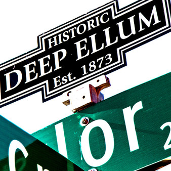 This street sign marks the lively historic Deep Ellum entertainment district,  located near downtown Dallas. Deep Ellum is a thriving artist community known for its vibrant street murals, quirky shops, art galleries, concert venues and restaurants.