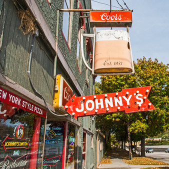 """<p>Johnny's was established in 1953 and has been """"Serving Up Tradition"""" ever since. Today, what was once just a workingman haven with cold beer and a jukebox has become a local favorite for sports fans and families – with 10 great locations and counting.<p><p>Click &lsquo;Choose a Product&rsquo; above to get this image hand printed on a ceramic 4x4 custom coaster, cutting board, magnet, ceramic trivet, ornament, dog tag or canvas.</p>"""
