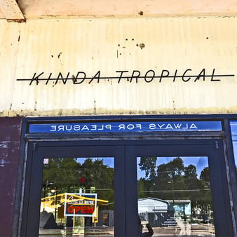 Kinda Tropical opened in April 2017 in a former gas station property where an A-1 Food Mart and used tire shop previously stood. Aside from its grocery store component, avocado toast, and sake, Kinda Tropical – a 2018 Best of Austin winner – is known for showcasing underground dance/electronic music from local artists and holding fundraisers for RAICES and Casa Marianela.