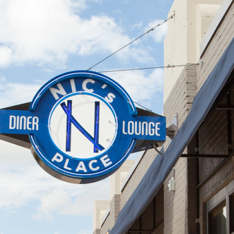 This classic old-hollywood diner and lounge is welcomed by this warm sign. Known for its great hospitality and positive energy, Nic's is your go-to place for any all-American dining.