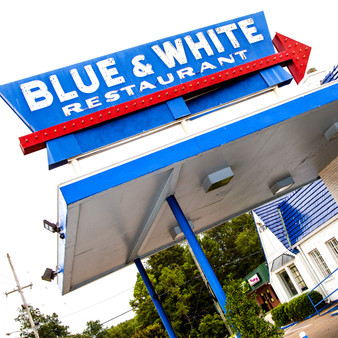 Blue and White Restaurant has been around since 1924! This tiny diner serves American fare & breakfast in a retro space with a counter.