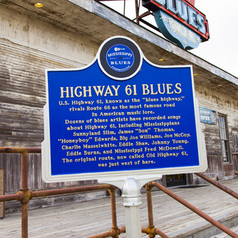 """U. S. Highway 61, known as the """"blues highway,"""" rivals Route 66 as the most famous road in American music lore. Dozens of blues artists have recorded songs about Highway 61, including Mississippians Sunnyland Slim, James """"Son"""" Thomas, """"Honeyboy"""" Edwards, Big Joe Williams, Joe McCoy, Charlie Musselwhite, Eddie Shaw, Johnny Young, Eddie Burns, and Mississippi Fred McDowell. The original route, now called Old Highway 61, was just west of here."""