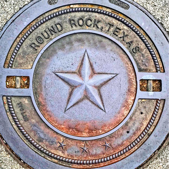 This manhole cover is from Round Rock, Texas.