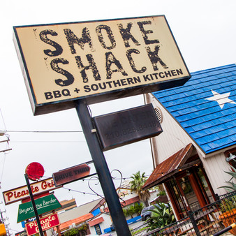 Known for their Brisket Grilled Cheese and Wagyu Brisket, Smoke Shack BBQ is a hopping counter-service place with a rustic, retro feel offering sandwiches, platters and sides.