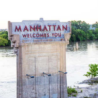<p>This sign welcomes people to Manhattan and can been seen by the Kansas River on Highway 177.<p><p>Click &lsquo;Choose a Product&rsquo; above to get this image hand printed on a ceramic 4x4 custom coaster, cutting board, magnet, ceramic trivet, ornament, dog tag or canvas.</p>
