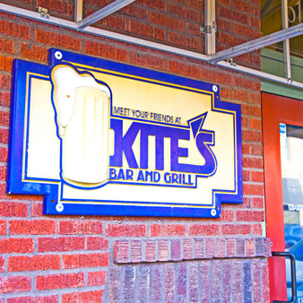 <p>Kite's Bar and Grill is a sports bar that caters to Kansas State University students offers beer & burgers.<p><p>Click &lsquo;Choose a Product&rsquo; above to get this image hand printed on a ceramic 4x4 custom coaster, cutting board, magnet, ceramic trivet, ornament, dog tag or canvas.</p>