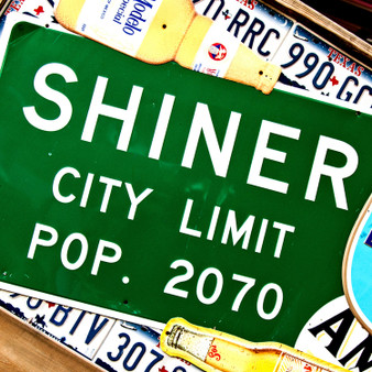 What would typically be welcoming you to Shiner, TX is this small-town's city limit sign.