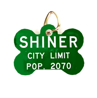This pet tag features the Shiner city limits sign.