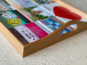 This coaster tray holds nine of our custom coasters and can be used as a display or to serve food/drinks!