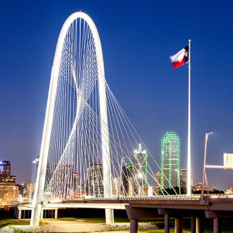 Spanning the Trinity River, the Margaret Hunt Hill Bridge – named after the philanthropist, Margaret Hunt – this bridge was built to be seen and awed at. Showcasing a glimpse of its dramatic detail, is a picture of the Hunt Hill bridge at night.