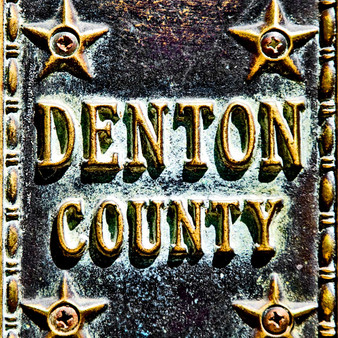 Officially welcoming those into Denton County, this aboriginal sign in Denton, Texas shows off its counties' legacy and history.