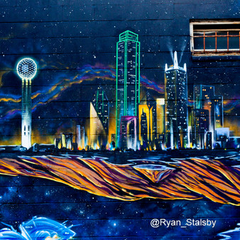 Creating an illustrated replica of the Dallas Skyline - a highly recognizable cityscape regularly featured in the 1980s hit series 'Dallas' - is this Dallas Skyline mural.