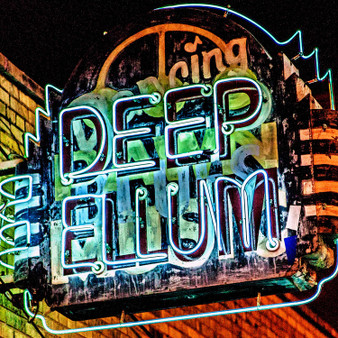 This vintage neon sign is located in the lively historic Deep Ellum entertainment district,  located near downtown Dallas. Deep Ellum is a thriving artist community known for its vibrant street murals, quirky shops, art galleries, concert venues and restaurants.