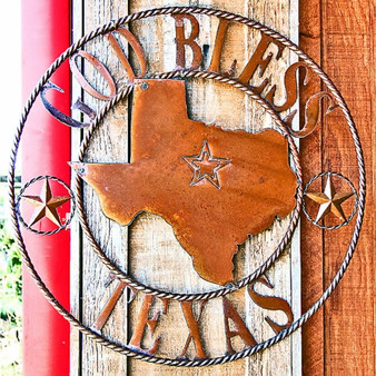 """Featuring a large hot in the center of America, this """"God Bless Texas"""" sign is one of several visitors will find, emphasizing the city and state's pride"""