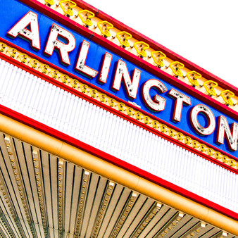 Exuding a loud and playful nature, this grand neon sign welcomes tourists and locals to the small town of Arlington.