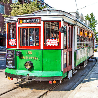 One of several M-Line trolleys, the Green Dragon has been operating since the 1980's. Transferring passengers through popular areas in Dallas such as the Arts District, West Village, and popular eateries, this trolley offers a ride through time as prehistoric stamps are seen all throughout its structure.