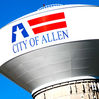 This massive water tower is located in Allen, Texas, behind the Nine Bands Brewing Company. The tower is painted white and has a stylized American flag and CITY OF ALLEN painted on it.