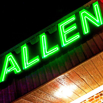 Representing Allen, TX in a bright green neon light, this sign welcomes you to its slightly small suburb just north of Dallas.