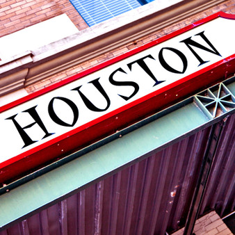 With deep red being one of Houston's most prideful colors, this red and white sign shows off Houston's pride.