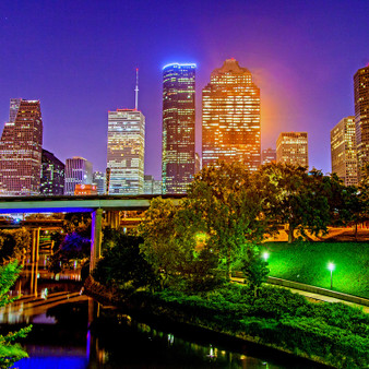 Featuring Houston at night, this glamorous shot captures the glitz and glam present in the San Antonio – Houston area that many fall in love with.