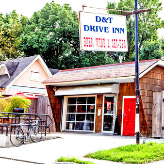 With a huge patio filled with several beer garden tables, D & T Drive Inn's casual setup with carefully selected craft brews and jukebox tunes makes for the perfect laidback hangout. Additionally, to provide a full-service experience, this Drive Inn features different food vendors constantly.