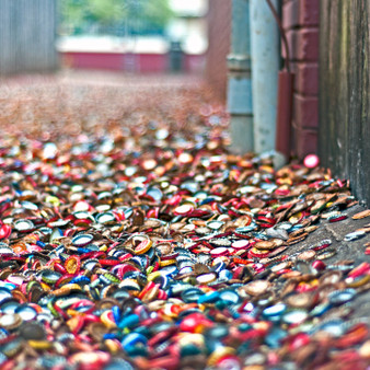 Close to the infamous college campus - Texas A & M - is the alley filled with bottle caps. Now as a historic landmark and major tourist attraction, the bottle cap alley has been around for decades, creating the tradition of students discarding their bottle caps here.
